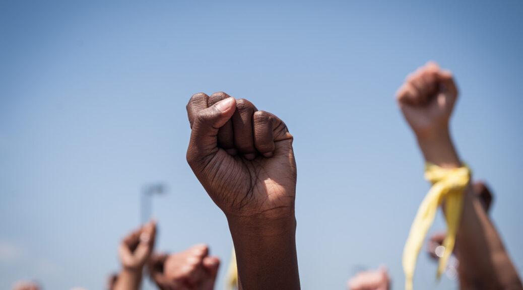 Raised fists.